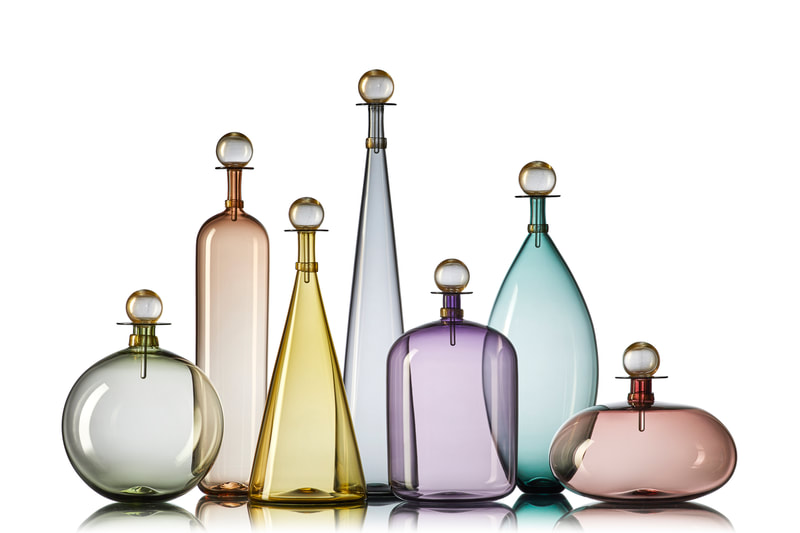Handblown glass bottles in colored glass inspired by midcentury decanter designs. By Vetro Vero